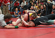 North Linn's Brendan Schott (top) pins Clayton Ridge's Kris Ihde in the 170-pound final at the Class 1A sectional wrestling tournament at East Buchanan High School in Wintrhop on Saturday, February 4, 2012. Schott won with a fall in :20. (Stephen Mally/Freelance)