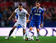 "SEVILLE, SPAIN - NOVEMBER 22:  Claudio Marchisio of Juventus (R) being followed by Victor Machin Perez ""Vitolo"" of Sevilla FC (L) during the UEFA Champions League match between Sevilla FC and Juventus at Estadio Ramon Sanchez Pizjuan on November 22, 2016 in Seville, .  (Photo by Aitor Alcalde/Getty Images)"