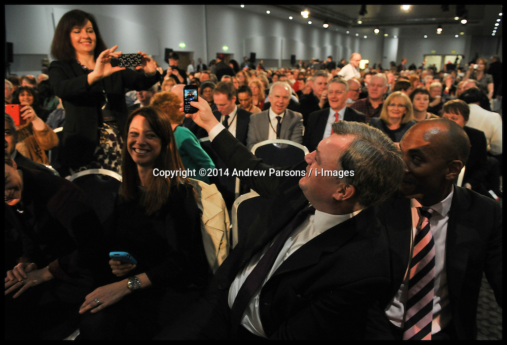 Ed Balls and Caroline Flint take pictures of each other at the Labour Party Special Conference being held at the Excel Centre. London, United Kingdom. Saturday, 1st March 2014. Picture by Andrew Parsons / i-Images