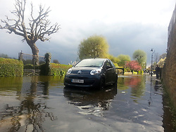 © London News Pictures. 27/04/2013 . London, UK.  A car in flood water where the River Thames has broken it's banks at  Chiswick in West London on Saturday, April 27, 2013. The flooding was caused by an unusually high spring tide. Photo credit : Stephen SImpson/LNP