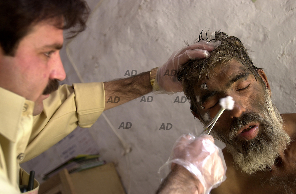 The Dost Welfare Foundation Darel Shiffa it?s a support centre for heroin addict. First aid on 24h, wash place, some tea and bread every day. Heroin could cost from 50 cent to 5$ each gram. Every month about ten people dead. The centre help an average of 30 people every month. It is a private foundation and don?t have any found by government, they work thank donations. *** Local Caption *** Abdullah, 55 years old afghan. Addict since 1980. Escaped from Kabul in 1984. Saved from the centre just in time, he was look like near to die. Some people of the centre take care of him.
