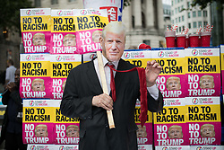 © Licensed to London News Pictures. 04/06/2019. London, UK. Anti-Trump protestors gather in Trafalgar square this morning on the second day of a state visit to the UK by U.S President Donald Trump. Photo credit: Joe Newman/LNP