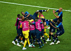 MOSCOW, RUSSIA - Sunday, July 15, 2018: France's Kylian Mbappe (hidden) celebrates scoring the fourth goal as Paul Pogba jumps into the huddle of players during the FIFA World Cup Russia 2018 Final match between France and Croatia at the Luzhniki Stadium. (Pic by David Rawcliffe/Propaganda)