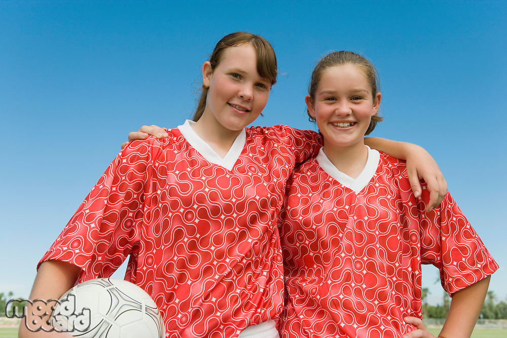 Two girls (13-17) dressed to play football portrait