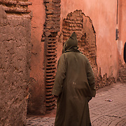 "The red walls of the city, built by Ali ibn Yusuf in 1122ñ1123, and various buildings constructed in red sandstone during this period, have given the city the nickname of the ""Red City"" or ""Ochre City"". <br /> <br /> Marrakesh or Marrakech or Me??akec, is a major city of Morocco. It is the fourth largest city in the country, after Casablanca, Rabat and Fes. It is the capital city of the mid-southwestern region of Marrakesh-Asfi. Located to the north of the foothills of the snow-capped Atlas Mountains. Marrakesh is possibly the most important of Morocco's four former imperial cities (cities that were built by Moroccan Berber empires). The region has been inhabited by Berber farmers since Neolithic times, but the actual city was founded in 1062 by Abu Bakr ibn Umar, chieftain and cousin of Almoravid king Yusuf ibn Tashfin. Marrakesh grew rapidly and established itself as a cultural, religious, and trading centre for the Maghreb and sub-Saharan Africa; Jemaa el-Fnaa is the busiest square in Africa.<br /> After a period of decline, the city was surpassed by Fes, but in the early 16th century, Marrakesh again became the capital of the kingdom. Beginning in the 17th century, the city became popular among Sufi pilgrims for Morocco's seven patron saints, who are entombed here.<br /> Tourism is strongly advocated by the reigning Moroccan monarch, Mohammed VI, with the goal of doubling the number of tourists visiting Morocco to 20 million by 2020. Despite the economic recession, real estate and hotel development in Marrakesh has grown dramatically in the 21st century. Marrakesh is particularly popular with the French, and numerous French celebrities own property in the city. Marrakesh has the largest traditional Berber market (souk) in Morocco, with some 18 souks selling wares ranging from traditional Berber carpets to modern consumer electronics. Crafts employ a significant percentage of the population, who primarily sell their products to tourists."