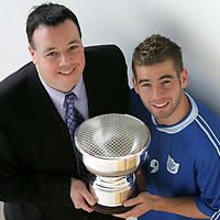 Peter MacDonald receives his player of the year trophy from St Johnstone business club secretary Steve McLaren.<br />