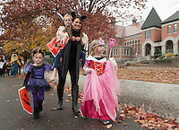 """Holy Trinity Catholic School's Halloween Parade walks through downtown Laconia followed by their """"trunk or treat"""" on Thursday afternoon.  (Karen Bobotas/for the Laconia Daily Sun)"""