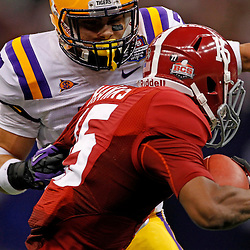 Jan 9, 2012; New Orleans, LA, USA; LSU Tigers cornerback Tyrann Mathieu (7) tackles Alabama Crimson Tide wide receiver Darius Hanks (15) during the first half of the 2012 BCS National Championship game at the Mercedes-Benz Superdome.  Mandatory Credit: Derick E. Hingle-US PRESSWIRE