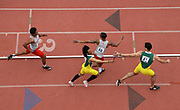 Apr 27, 2018; Philadelphia, PA, USA; Kahmari Montgomery of Houston (top) takes the handoff from Thomas Alcorn and Tyler Brown of Eastern Michigan takes the baton from Owen Richardson on the anchor leg  of a 4 x 400m relay heaat during the 124th Penn Relays at Franklin Field.