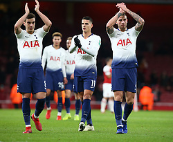 December 19, 2018 - London, England, United Kingdom - London, UK, 19 December, 2018.L-R Tottenham Hotspur's Harry Winks,Tottenham Hotspur's Erik Lamela and Tottenham Hotspur's Toby Alderweireld.Salute they fans.during Carabao Cup Quarter - Final between Arsenal and Tottenham Hotspur  at Emirates stadium , London, England on 19 Dec 2018. (Credit Image: © Action Foto Sport/NurPhoto via ZUMA Press)