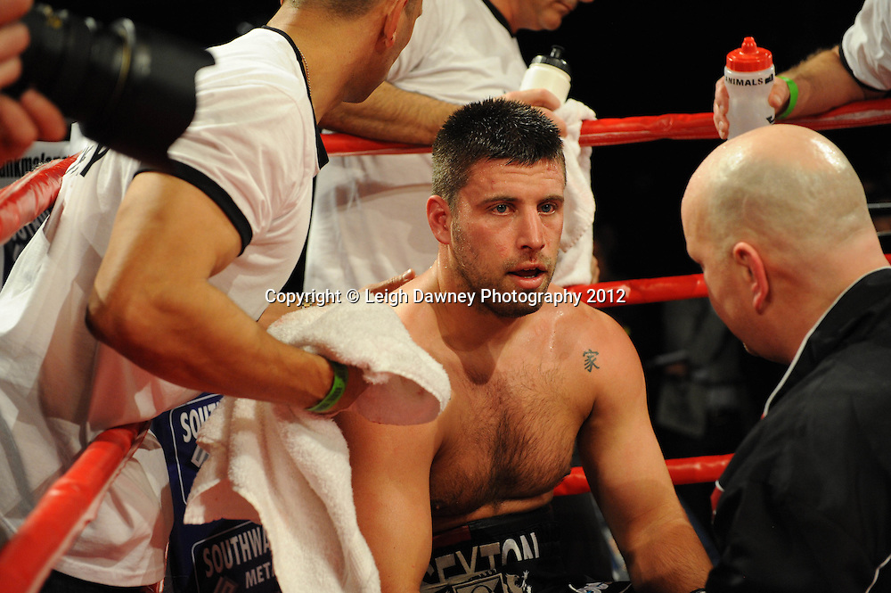 David Price defeats Sam Sexton (pictured in corner) in a 12x3 contest to claim the British & Commonwealth, Heavyweight Title at the Aintree Equestrian Centre, Liverpool on the 19th May 2012. Frank Maloney Promotions © Leigh Dawney Photography 2012.