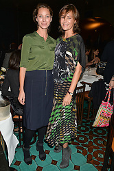 Left to right, CHRISTY TURLINGTON BURNS and YASMIN LE BON at a dinner in honour of Christy Turlington hosted by Porter magazine at Mr Chow, Knightsbridge, London on 18th November 2014.