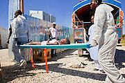 19 NOVEMBER 2010 - PORT-AU-PRINCE, HAITI:  Workers bring new patients into a Medicins Sans Frontieres (MSF - Doctors Without Borders) cholera treatment center near the airport in Port-au-Prince. Cite Soleil, a sprawling slum area in PAP is ground zero for the cholera epidemic in the Haitian capital. An outbreak of cholera in northern Haiti about a month ago has spread across the nation. Tens of thousands of people have been hospitalized and treated for cholera and more than 1,100 have died. Cholera is a water borne illness that causes severe diarrhea and death by dehydration in a matter of hours.     PHOTO BY JACK KURTZ    choleraepidemic