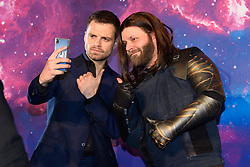 Sebastian Stan (left) poses with a Marvel cosplayer attending the Avengers: Infinity War UK Fan Event held at Television Studios in White City, London.