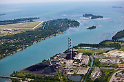 Power plant on the banks of the Detroit River before its confluence in to Lake Erie. Grosse Ile Municipal Airport across the water to the left.