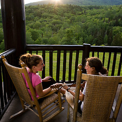 Two young women sing on the porch at the Moosilauke Ravine Lodge in New Hampshire USA (MR)
