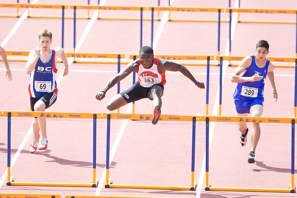 (Sherbrooke, Quebec---9 August 2008) Matthew Daly-Grafstein (69), Oluwasegun Makinde (363), and Matthew Bellefontaine (289) competing in the youth boys 110m hurdles final at the 2008 Canadian National Youth and Royal Canadian Legion Track and Field Championships in Sherbrooke, Quebec. The photograph is copyright Sean Burges/Mundo Sport Images, 2008. More information can be found at www.msievents.com.