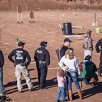 102613       Cable Hoover<br /> <br /> Law enforcement officers and their families keep on an eye to the shooting range during the inter-agency shooting competition in Milan Saturday.
