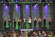 Photo of ten dancers onstage in front of a crowd at the Dublin Irish Festival in Dublin, Ohio.