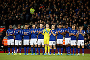 Everton players take part in the minutes applause in memory of the 96 during the Premier League match between Liverpool and Everton at Anfield, Liverpool, England on 4 December 2019.
