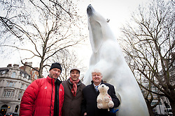 © Licensed to London News Pictures. 14/01/2013. London, UK. Polar explorer Jim McNeill (L), artist Adam Binder (C) and  environmental campaigner Stanley Johnson (the father of Boris Johnson, the Mayor of London) are seen next to a bronze polar bear statue called 'Boris' in Sloane Square in London today (14/01/12).  The sculpture by Adam Binder, 12 foot tall, weighing 700 kilograms, and on display for the next 28 days, was placed in Sloane Square to launch an urgent 28 day campaign calling for a ban on the killing of polar bears for their body parts.  Photo credit: Matt Cetti-Roberts/LNP