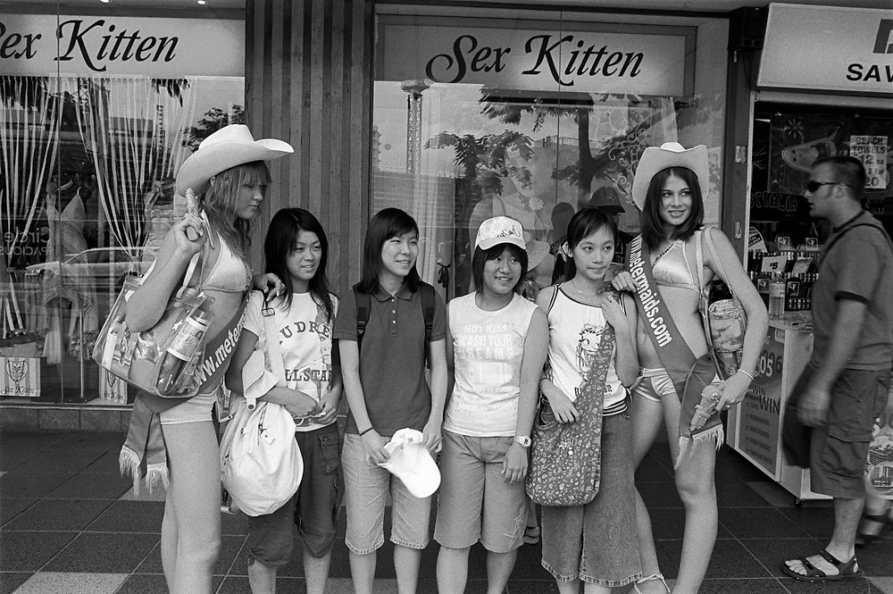 Meter Maids, Jessica 18 years and Hannah 15 years getting their photo taken with Japanese tourists.