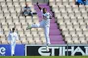 Hampshire bowler Fidel Edwards leaps for joy after taking the opening wicket of Warwickshire batsman Ian Westwood during the Specsavers County Champ Div 1 match between Hampshire County Cricket Club and Warwickshire County Cricket Club at the Ageas Bowl, Southampton, United Kingdom on 12 April 2016. Photo by Graham Hunt.