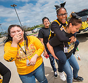 The Sam Houston Math, Science and Technology Center boy's basketball team parade to the school before leaving for the UIL State Basketball Tournament, March 10, 2016.