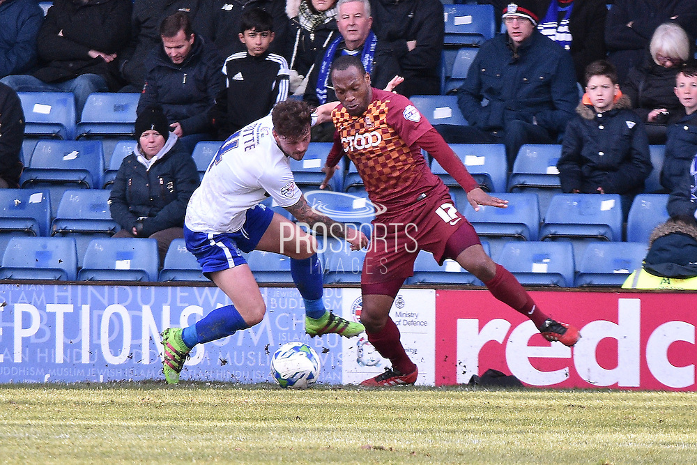 Bradford City Midfielder, Kyel Reid and Bury Midfielder, Andrew Tutte battle during the Sky Bet League 1 match between Bury and Bradford City at the JD Stadium, Bury, England on 5 March 2016. Photo by Mark Pollitt.