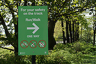 Signage in Central Park: For your safety on the track Run/Walk One Way.