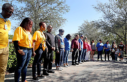 People stop for a moment of silence at 10:17 a.m. at Pine Trails Park in Parkland, Fla., in honor of all 17 of the victims killed last year at the school. Photo by Mike Stocker/Sun Sentinel/TNS/ABACAPRESS.COM