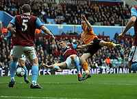 James Milner Scores own goal as he's challenged by Wolves's David Jones<br /> Aston Villa 2009/10<br /> Aston Villa V Wolverhampton Wanderers 20/03/10<br /> The Premier League<br /> Photo Robin Parker Fotosports International