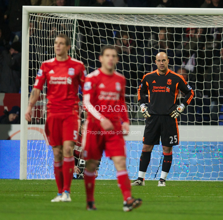 BOLTON, ENGLAND - Saturday, January 21, 2011: Liverpool's goalkeeper Jose Reina looks dejected as Bolton Wanderers' score the third goal during the Premiership match at the Reebok Stadium. (Pic by David Rawcliffe/Propaganda)