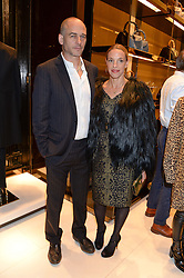 DINOS CHAPMAN and TIPHAINE de LUSSY at a party hosted by Gucci & Clara Paget to drink a new cocktail 'I Bamboo You' held at Gucci, 34 Old Bond Street, London on 16th October 2013.