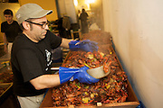 BROOKLYN, NY - MAY 23, 2012: Theo Peck serves out crayfish for Edible Brooklyn's Crawfish Boil at the Brooklyn Brewery. CREDIT: Clay Williams for Edible Brooklyn.<br />