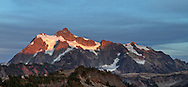 Last bit of sunse light on the glaciers of Mount Shuksan, Shuksan Arm and Huntoon Point. Photographed in early October from the Chain Lakes Trail in the Mount Baker Wilderness, Washington State, USA.