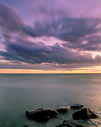 Scenic Lake Ontario, with dramatic clouds and foreground rocks (One of the Great Lakes) Oswego, New York