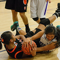 020414 Cayla Nimmo/For the Independent<br /> <br /> Gallup Bengal Ni'Asia McIntosh (34) struggles with Miyamura Patriot Amber Antez (24) for control of the ball Tuesday at Miyamura High School.
