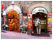 Gift shops line a street in Assisi, Italy. (Sam Lucero photo)