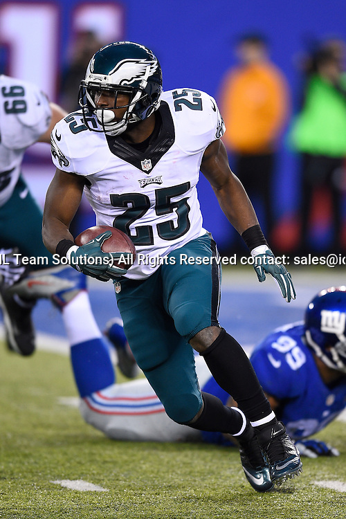 December 28, 2014: Philadelphia Eagles running back LeSean McCoy (25) carries the ball during the second half of a NFL Eastern matchup between the Philadelphia Eagles and the New York Giants at MetLife Stadium in East Rutherford, New Jersey. the Eagles defeated the Giants 34-26.