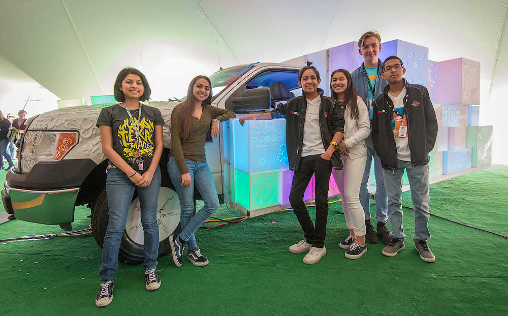 Students from the Energy Institute High School pose for a photograph with an art car on display at Discovery Green they created in partnership with Noble Energy.