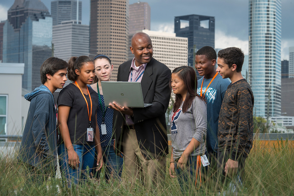 Teacher Juan Garner talks with students on the green roof at Carnegie Vanguard High School, September 18, 2015.