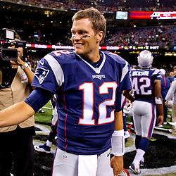 Aug 22, 2015; New Orleans, LA, USA; New England Patriots quarterback Tom Brady (12) gives a thumbs up to New Orleans Saints quarterback Drew Brees (not pictured) following a preseason game at the Mercedes-Benz Superdome. The Patriots defeated the Saints 26-24. Mandatory Credit: Derick E. Hingle-USA TODAY Sports