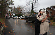 Xavier Mascareñas/Newsday; North Salem Police Ofc. Michael Castellano hugs a neighbor, who did not want to be identified, after two boys were killed by a tree that fell on a home on Bonnieview Street in North Salem during superstorm Sandy the prior evening. (Oct. 30, 2012)