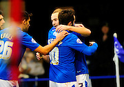 Portsmouth's Marc McNulty is congratulated by his team mates on scoring the opening goal during the The FA Cup match between Portsmouth and Accrington Stanley at Fratton Park, Portsmouth, England on 5 December 2015. Photo by Graham Hunt.