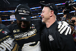 UCF Knights head coach Scott Frost celebrates beating the Auburn Tigers during the 2018 Chick-fil-A Peach Bowl NCAA football game on Monday, January 1, 2018 in Atlanta. (Jason Parkhurst / Abell Images for the Chick-fil-A Peach Bowl)
