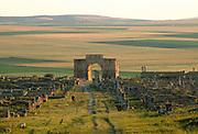 MOROCCO, ROMAN HISTORY Volubilis, 1-3C AD, Roman city in the Roman province of Mauretania Tingitana; view of Caracalla's Arch and town site
