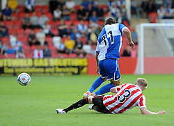 A strong challenge from George McLennan of Cheltenham Town on Jake Gosling of Bristol Rovers - Mandatory by-line: Neil Brookman/JMP - 25/07/2015 - SPORT - FOOTBALL - Cheltenham Town,England - Whaddon Road - Cheltenham Town v Bristol Rovers - Pre-Season Friendly