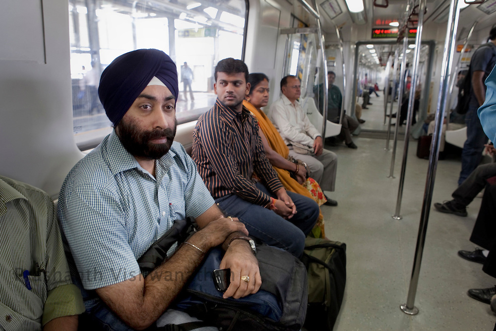"Arvider Singh, 29, (with turban) travels inside a metro train from the Central Secratariat station using the ""Yellow Line"" route of the Delhi Metro network in New Delhi, India, on Friday, October 22, 2010. Photographer: Prashanth Vishwanathan/HELSINGIN SANOMAT"