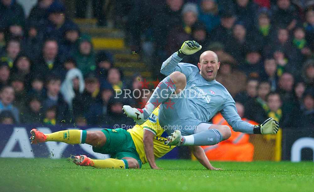 NORWICH, ENGLAND - Saturday, April 28, 2012: Liverpool's goalkeeper Jose Reina is tackled by Norwich City's James Vaughan during the Premiership match at Carrow Road. (Pic by David Rawcliffe/Propaganda)